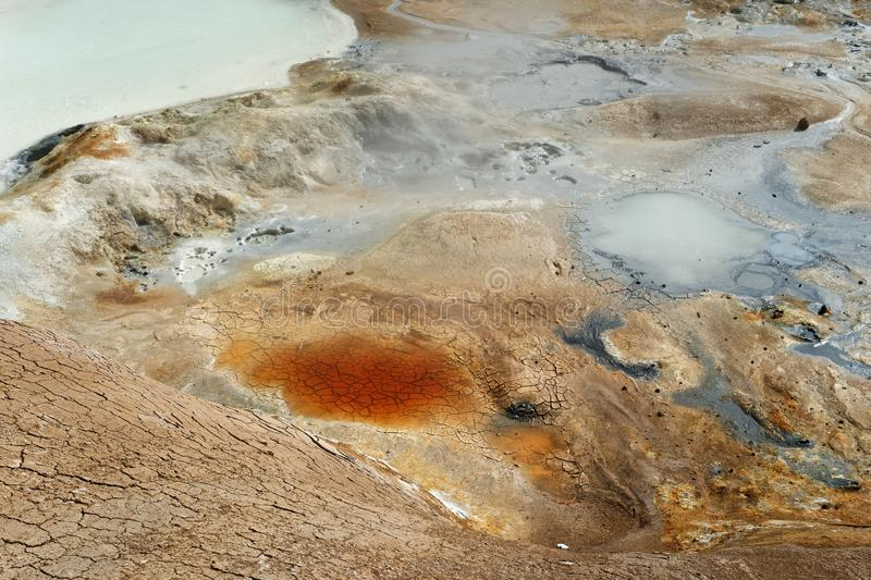 Iceland - volcanic landscape - geothermal area. Active geothermal area with colorful soils, mud holes and water surfaces, detailed view - Location: Iceland stock photography