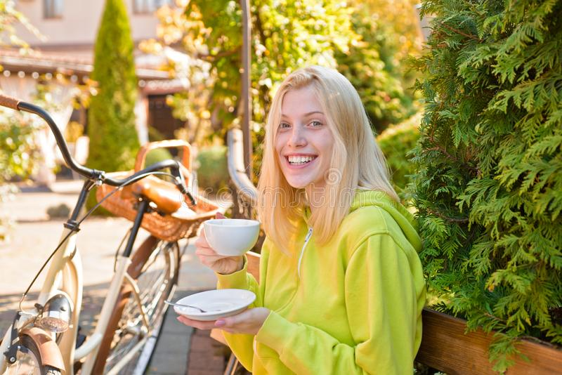 Active girl with bicycle. Motion and energy. Woman with bicycle in blooming garden. Weekend activity. Active leisure and royalty free stock photography
