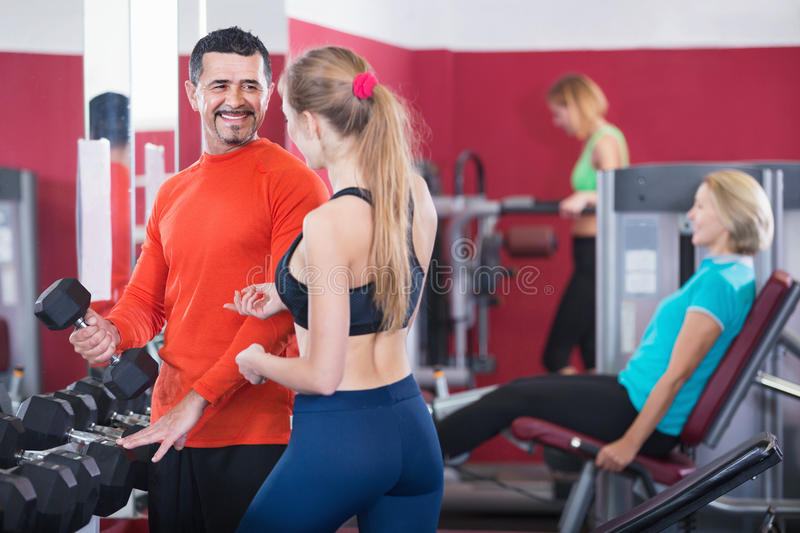 Active glad people weightlifting training in health club royalty free stock image