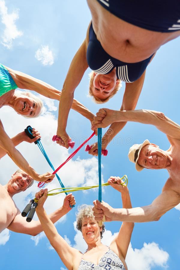 Group of seniors at the gym gymnastics. Active group of seniors with skipping rope in a circle at the rehab gym royalty free stock images