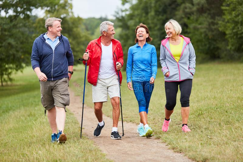 Active group of seniors walking stock photography