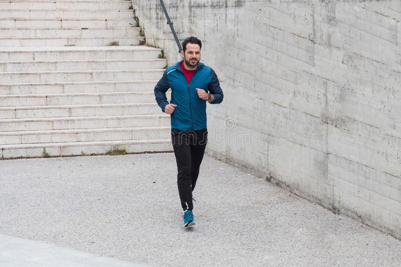 Sportive urban city man running on the stairs royalty free stock photos