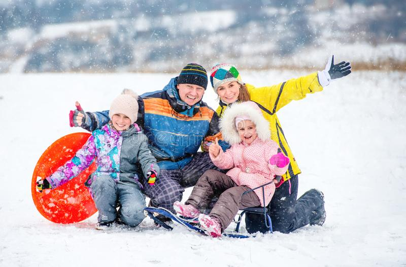 Happy family portrait outdoors at winter time royalty free stock photo