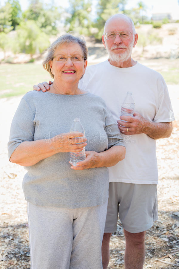Active Happy Healthy Senior Couple with Water Bottles. Happy Healthy Senior Couple with Water Bottles Outdoors stock images