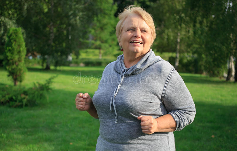Active and happy senior woman stock photography