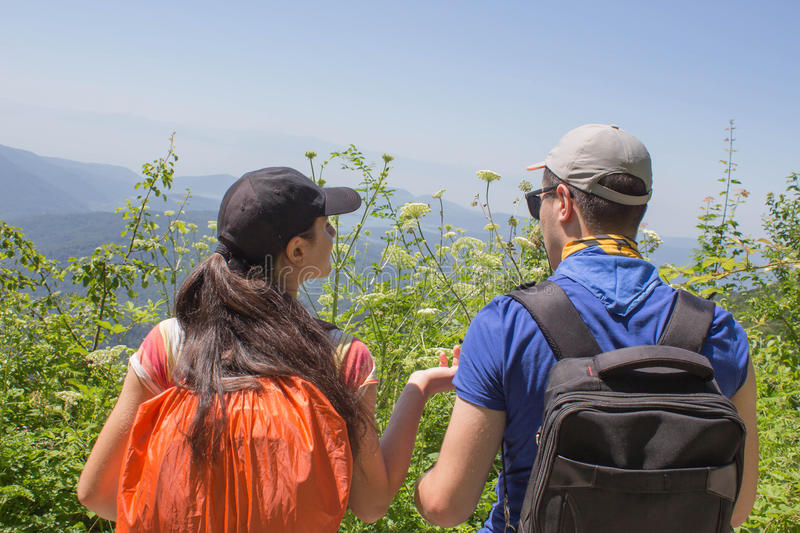Active and healthy lifestyle on summer vacation and weekend tour. Active hikers. Travel adventure and hiking activity. Two young Tourists With Backpacks travel royalty free stock photography