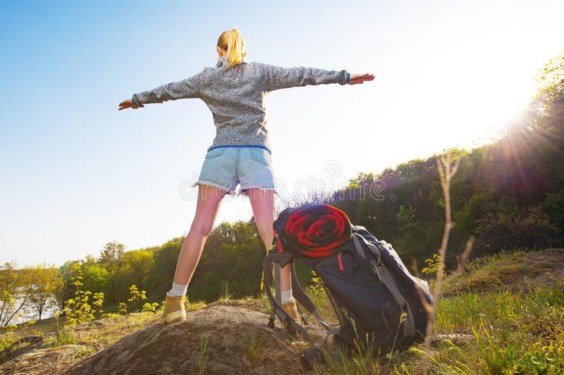 Active healthy woman hiking in beautiful forest. Happy young woman resting of forest clearing during hike holidays. royalty free stock images