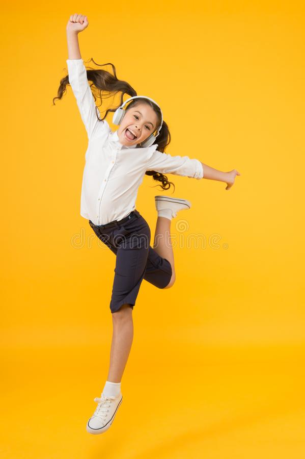Free Active Kid. Girl On Way To Knowledge. Knowledge Day. Back To School. Kid Cheerful Schoolgirl Full Energy Jump. Pupil Royalty Free Stock Photo - 155862585
