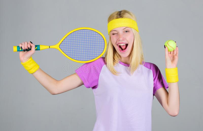 Active leisure and hobby. Athlete hold tennis racket in hand on grey background. Tennis sport and entertainment. Tennis. Club concept. Girl adorable blonde play royalty free stock photography