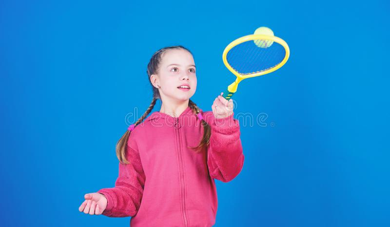 Active leisure and hobby. Tennis sport and entertainment. Girl adorable child play tennis. Practicing tennis skills and stock photo