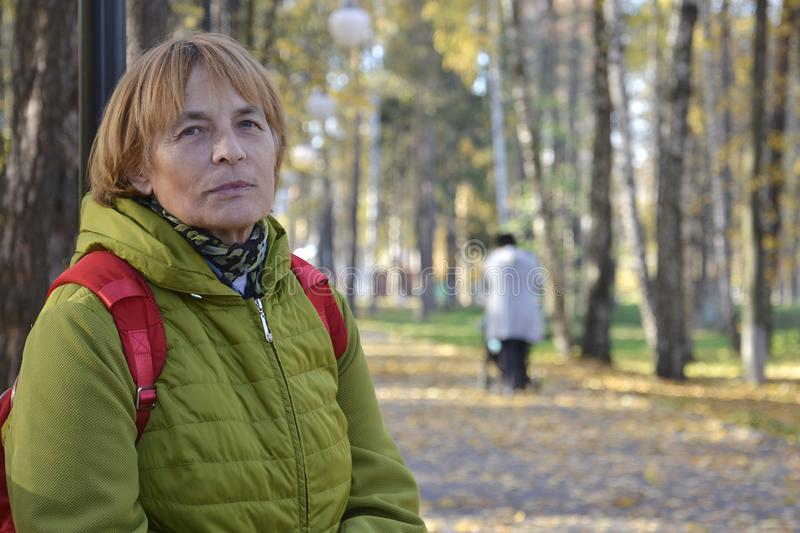 Active lifestyle of the elderly in the autumn park stock image