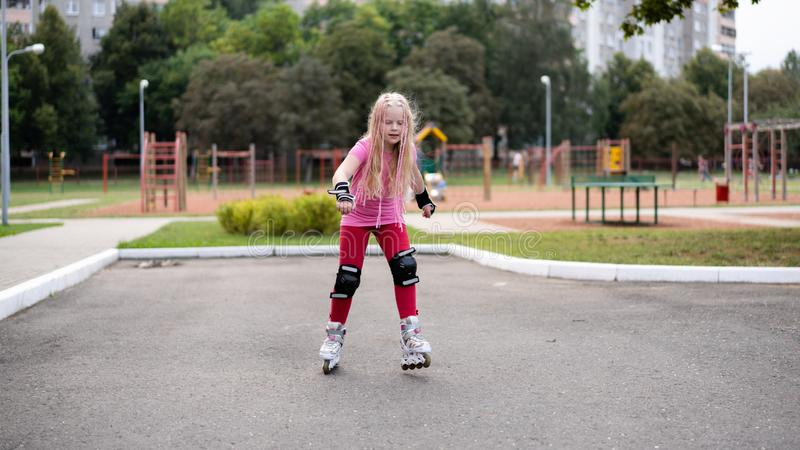 Active lifestyle in a modern city - active lifestyle in a modern city - stylish girl roller-blading in a stadium. Active lifestyle in a modern city - stylish royalty free stock images