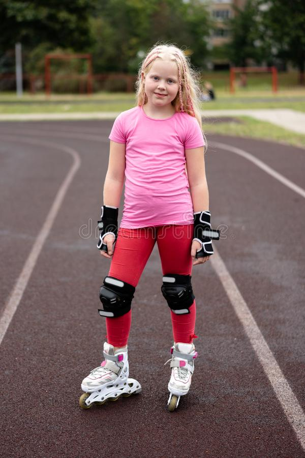 Active lifestyle in a modern city - active lifestyle in a modern city - stylish girl roller-blading in a stadium. Active lifestyle in a modern city - stylish royalty free stock photos