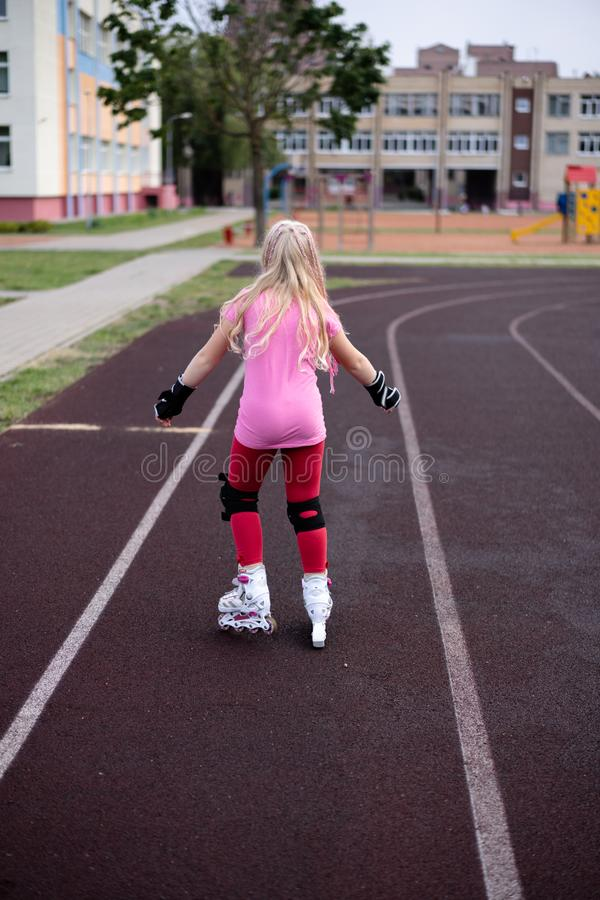 Active lifestyle in a modern city - active lifestyle in a modern city - stylish girl roller-blading in a stadium. Active lifestyle in a modern city - stylish stock images