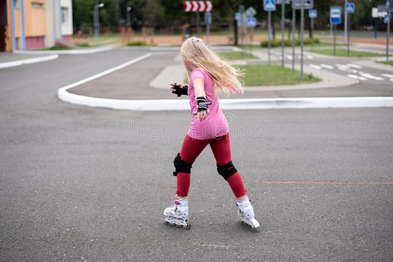 Active lifestyle in a modern city - active lifestyle in a modern city - stylish girl roller-blading in a stadium. Active lifestyle in a modern city - stylish royalty free stock photography