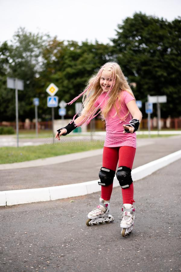 Active lifestyle in a modern city - active lifestyle in a modern city - stylish girl roller-blading in a stadium. Active lifestyle in a modern city - stylish royalty free stock image
