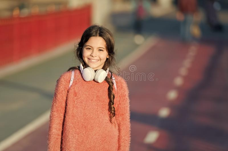 Active lifestyle music play list. Girl cute child with headphones. Reasons you should use headphones. Headphones changed stock photos