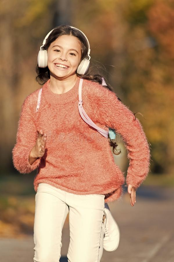 Active lifestyle music play list. Music always with me. Girl cute child with headphones. Reasons you should use royalty free stock photography