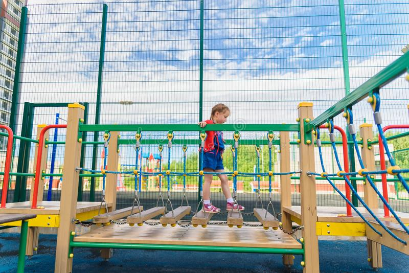Active little girl on playground royalty free stock image