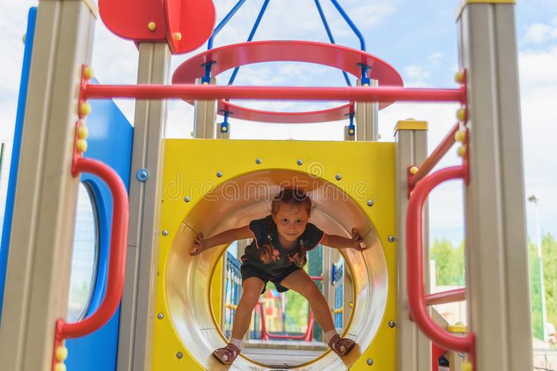 Active little girl on playground stock image