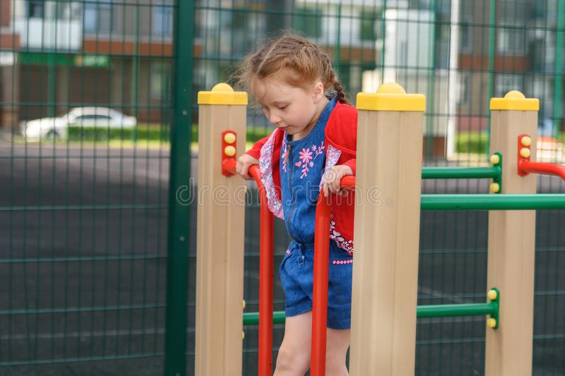 Active little girl on playground stock images