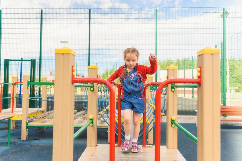 Active little girl on playground royalty free stock photo