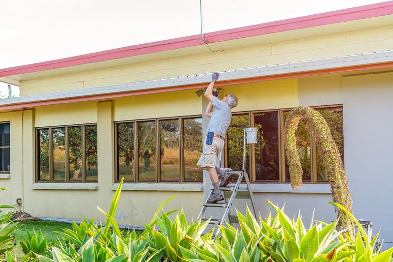 Retired Man House Painting stock photos