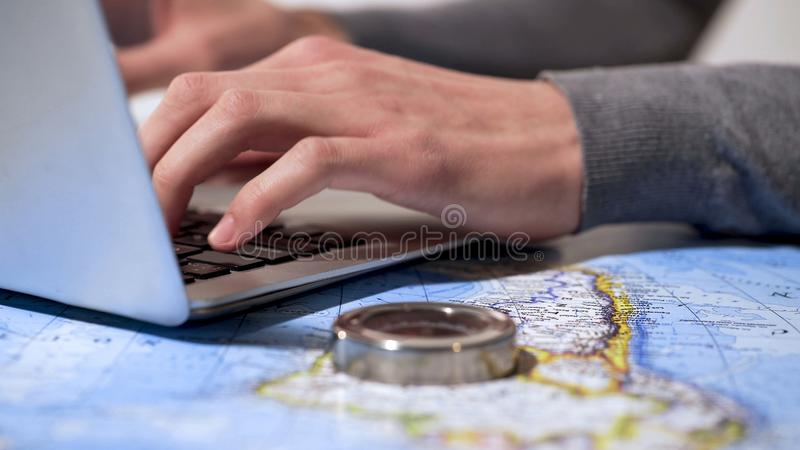 Active man buying tickets online on laptop, planning vacation or business trip. Stock photo royalty free stock photos