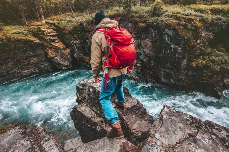 Active man hiker traveling with backpack alone royalty free stock images