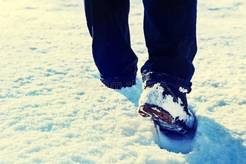Active man hiking in snow covered countryside royalty free stock photography
