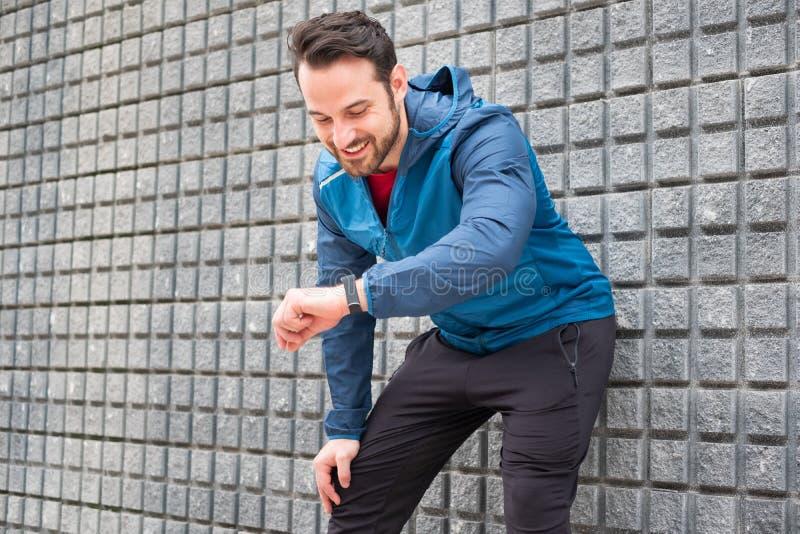 Active man portrait using smartwatch fitness app stock images
