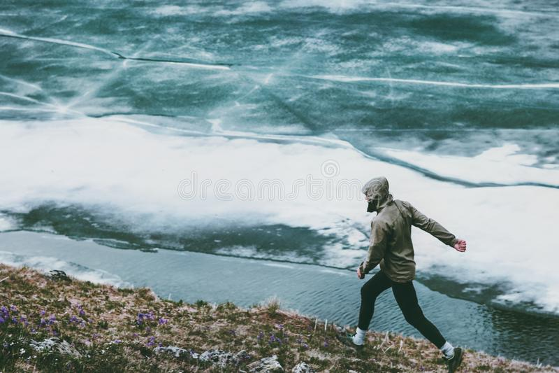 Active Man running at frozen lake Travel royalty free stock photo