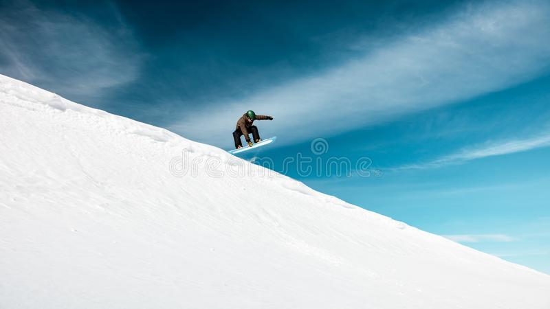 Active man on snowboard stock image