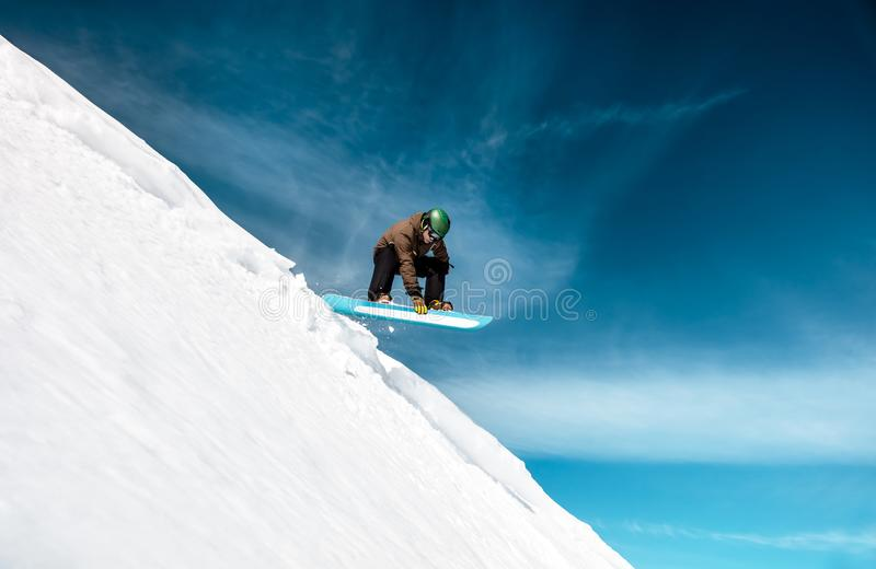 Active man snowboarding stock photo