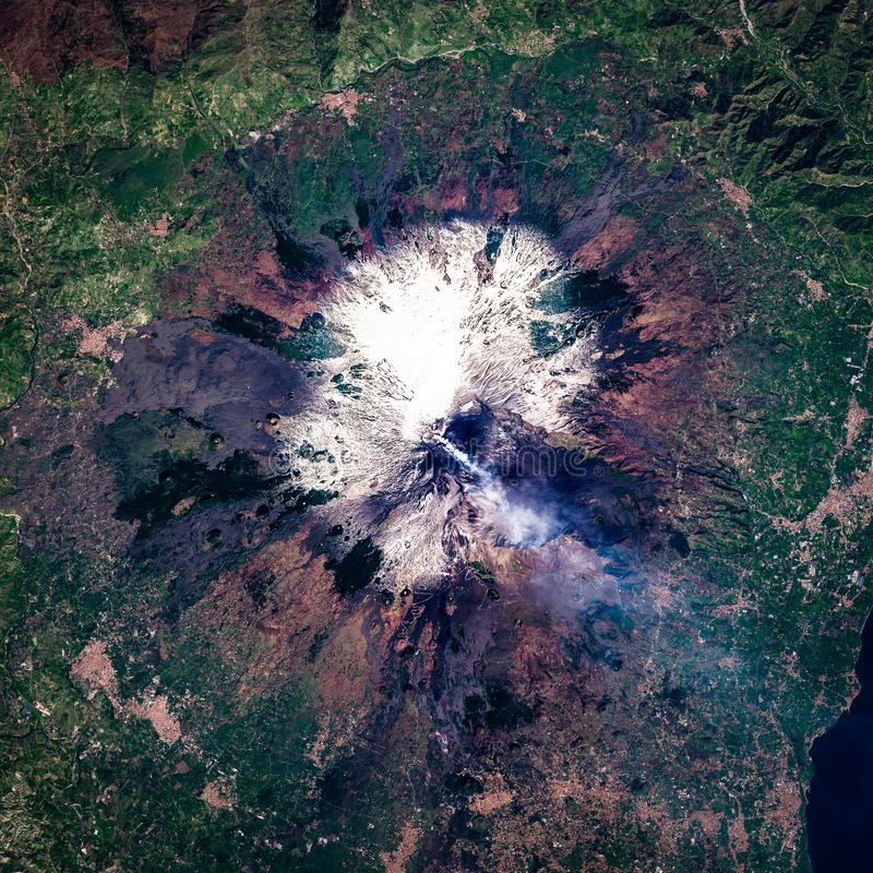 Active Mount Etna volcano eruption, crater blows smoke, high resolution satellite image, aerial view royalty free stock photo