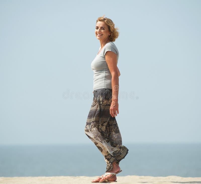 Woman Enjoying At Beach Stock Image Image Of Pleasure: Active Older Woman Walking At The Beach Stock Image