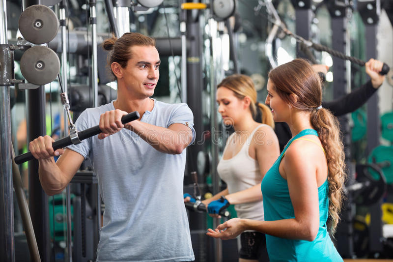 Active people having weightlifting training in club stock photography