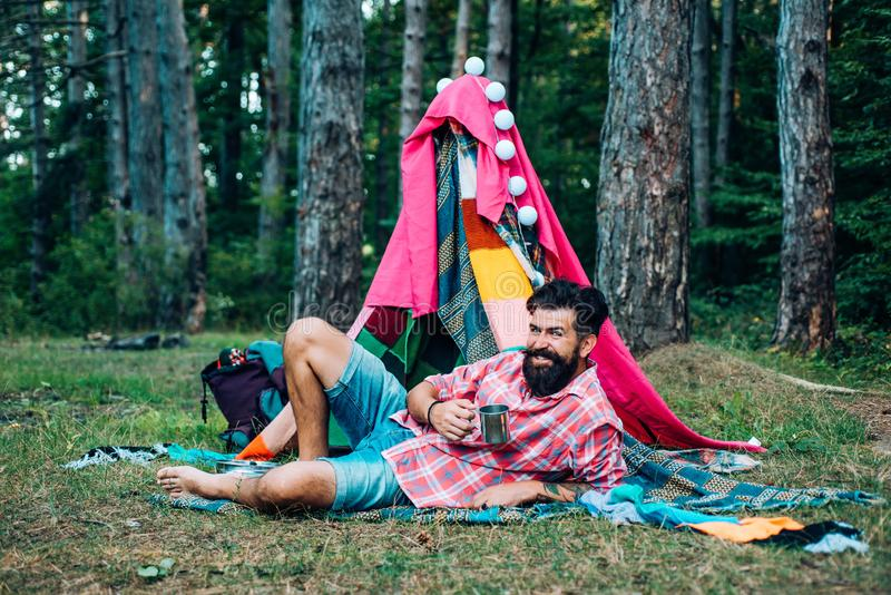 Active people. Play tent. Hovel decorated party. Homemade tent - hut. Adventure travel. Camping and tent near beautiful royalty free stock photo