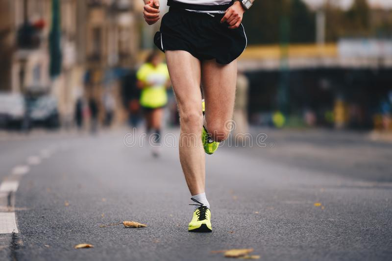 Active people running autumn fall marathon race in the city downtown. Healthy lifestyle stock photos
