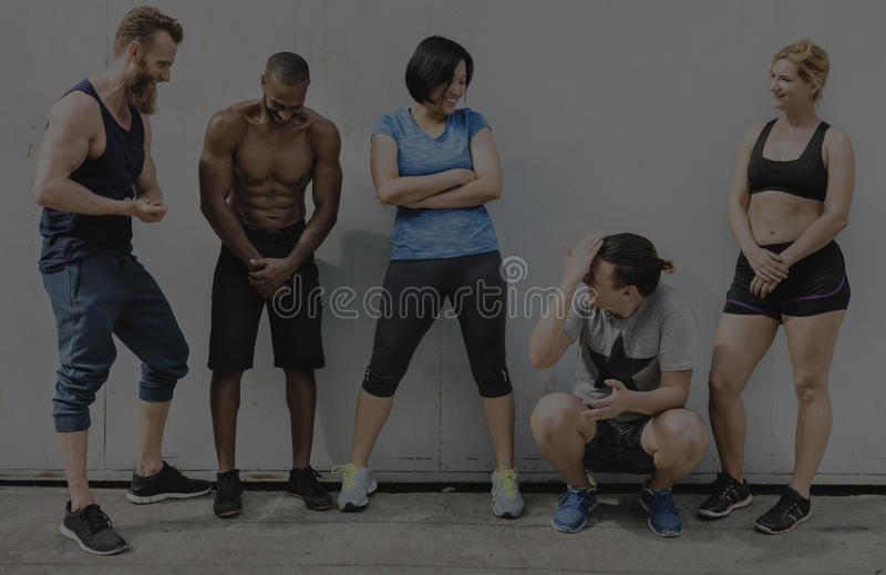 Active People Sport Workout Concept. Group of workout people staying together by the wall stock photo