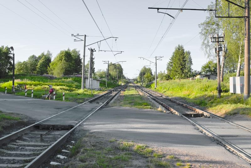 Railroad crossing in the countryside. royalty free stock photography