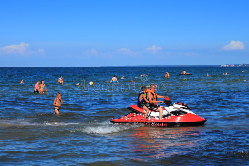 Active recreation - driving on a hydrocycle on the Baltic Sea. KULIKOVO, RUSSIA — JULY 19, 2014: Active recreation - driving on a hydrocycle on the Baltic stock photos