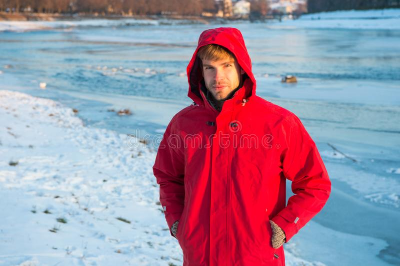 Active rest. travel and expedition concept. man in parka. winter male fashion. warm clothes for cold climate. weather stock photos