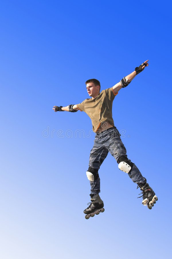 Active roller boy jumping royalty free stock image