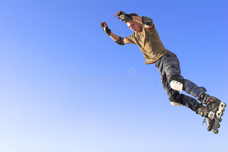 Active roller boy jumping stock photo