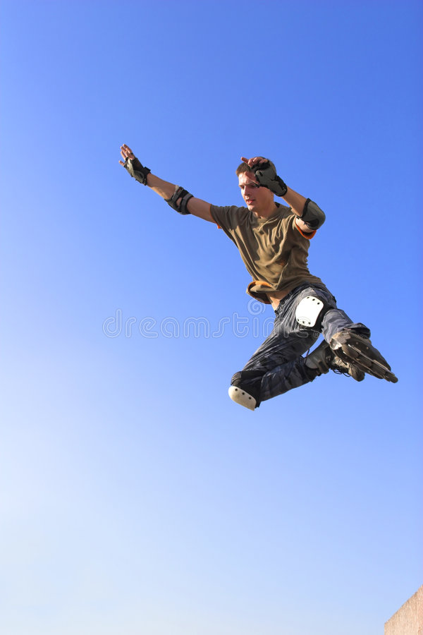 Active roller boy jumping stock images