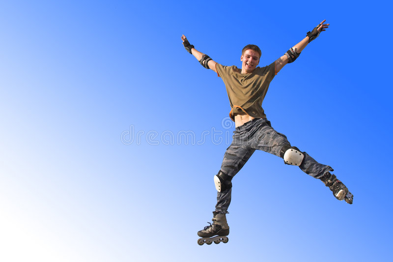 Active roller boy jumping royalty free stock photo
