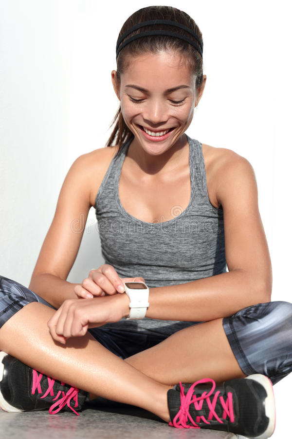 Active runner woman using activity tracker fitness smartwatch. Active runner woman using activity tracker smartwatch as heart rate monitor for workout tracking royalty free stock photos