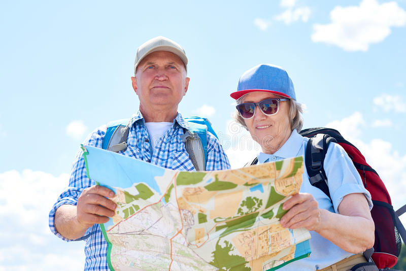 Active Senior Couple on Hiking Trip stock photos