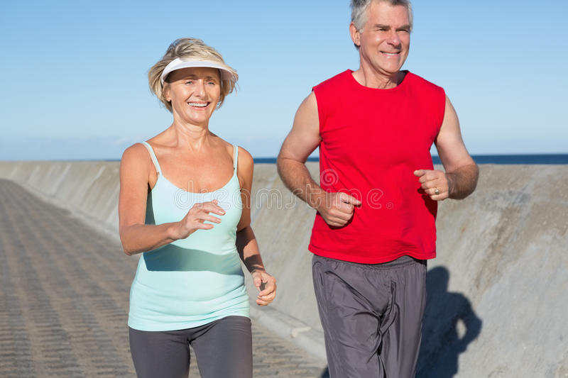 Active senior couple out for a jog stock photo